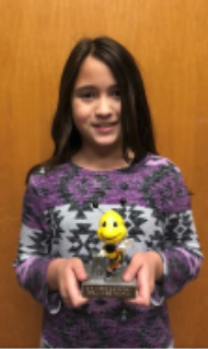 Spelling Bee  Winner girl holding trophy
