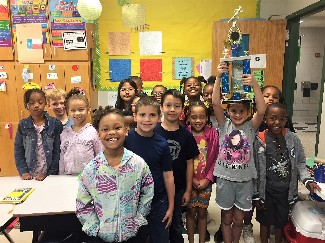 Mrs. Meneses' class with trophy